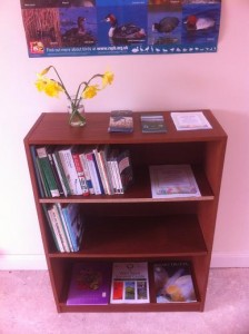 Donated bookcase and nature books